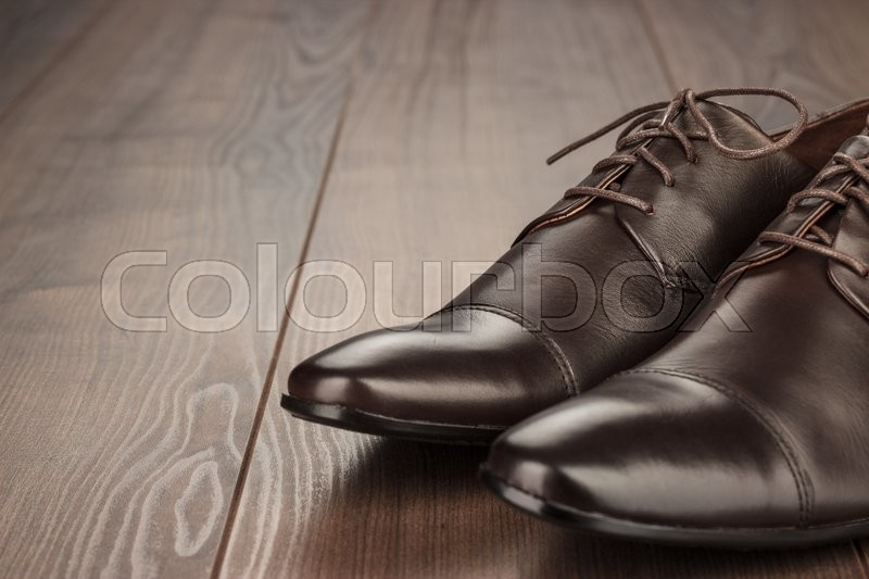 Stock image of 'brown leather shoes on the wooden background'