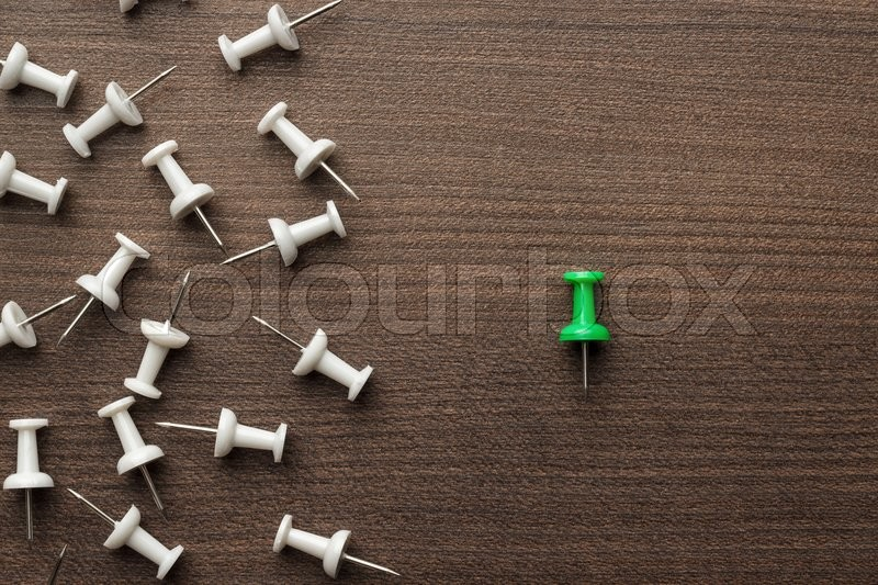 Stock image of 'bright green push pin out of the crowd concept'