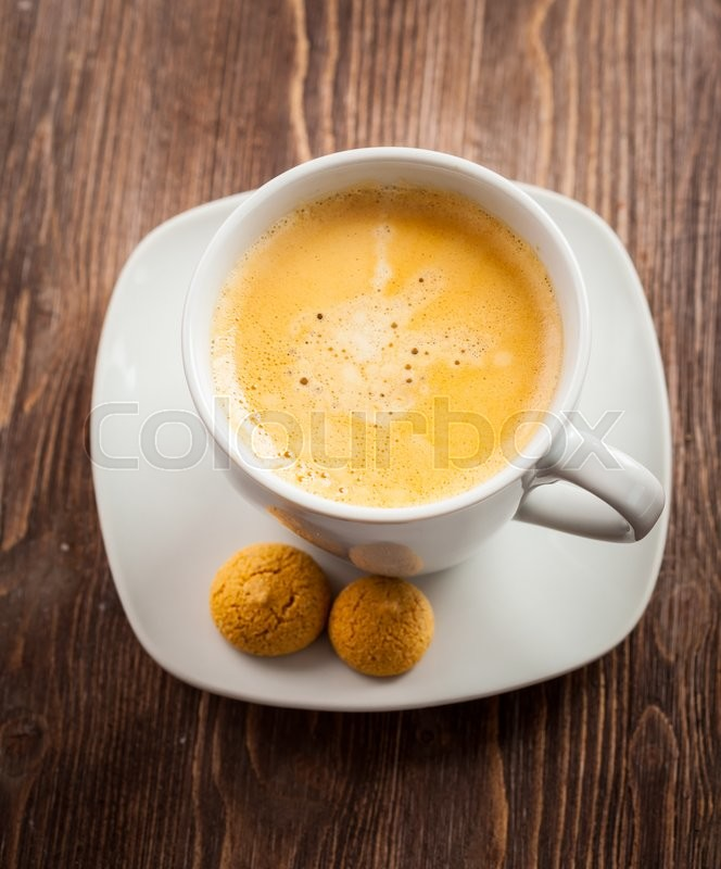 Stock image of 'Cup of coffee on wooden table'