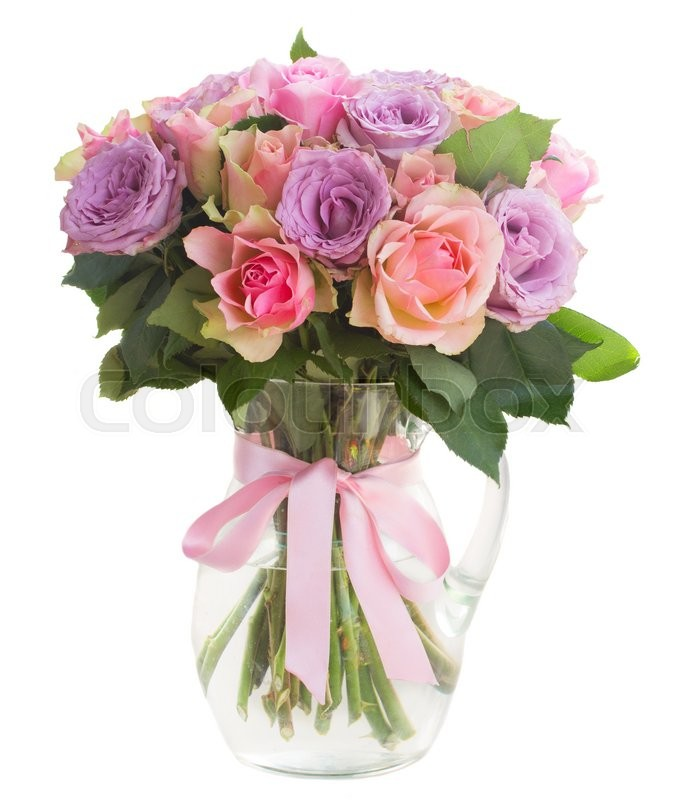 Stock image of 'bouquet of pink and violet  fresh roses inn glass  vase isolated on white background'