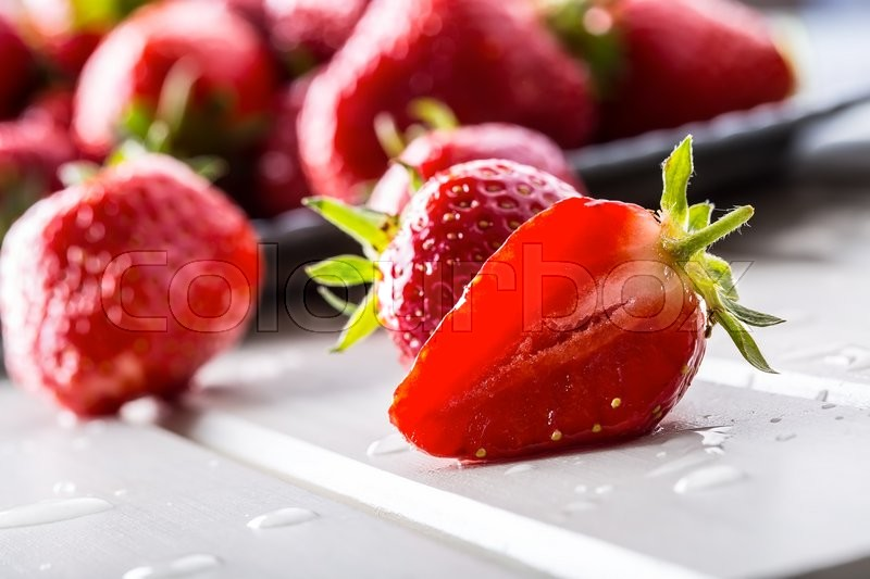 Stock image of 'Strawberry. Fresh strawberry. Red strewberry. Strawberry Juice. Loosely laid strawberries in different positions.'