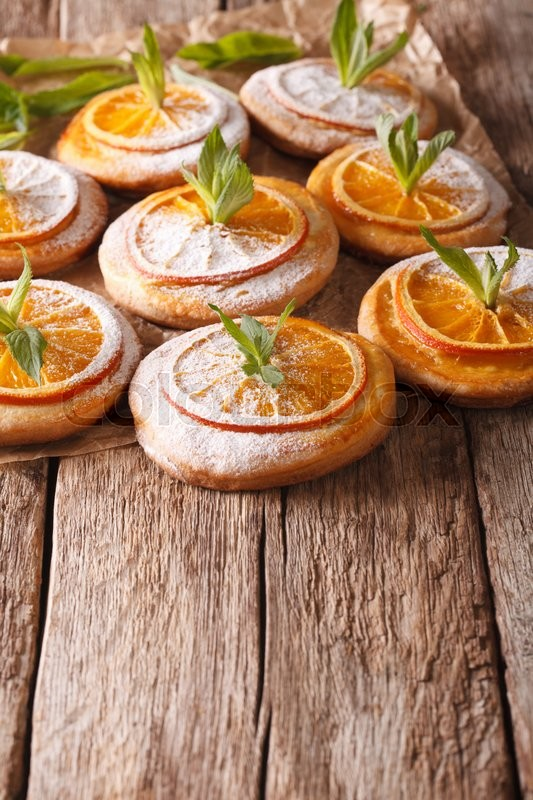 Stock image of 'Tasty cookies with orange slices and mint on the table. vertical\'