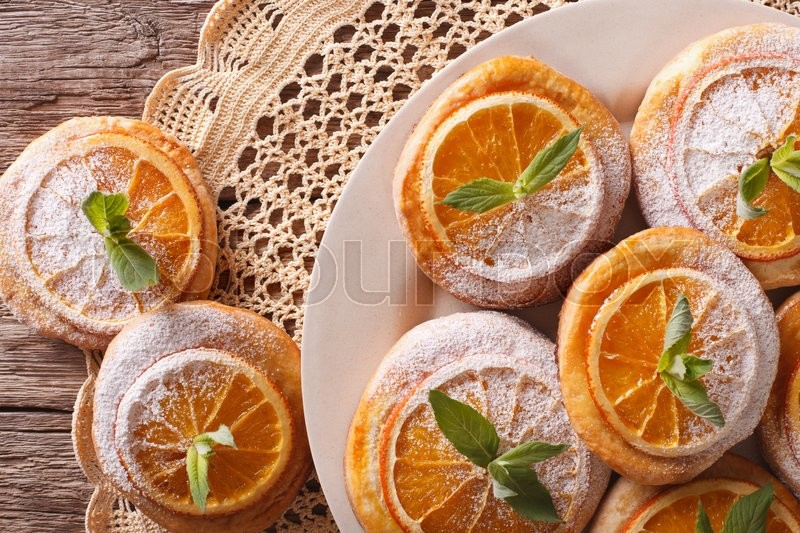 Stock image of 'Homemade cookies with almonds and oranges closeup on a plate. horizontal view from above\'