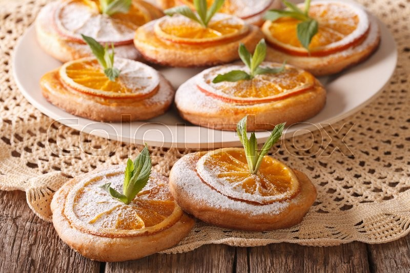 Stock image of 'Homemade cookies with almonds and oranges closeup on a plate. horizontal\'