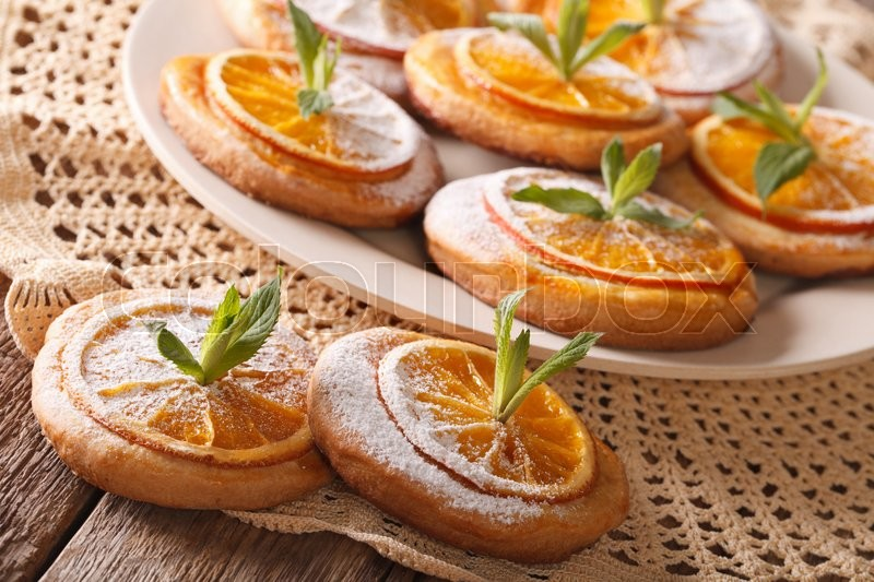 Stock image of 'Tasty almond cookies with citrus close-up on a plate. horizontal\'