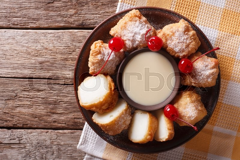 Stock image of 'fried milk and condensed milk decorated with cherries close-up on a plate. Horizontal view from above\'