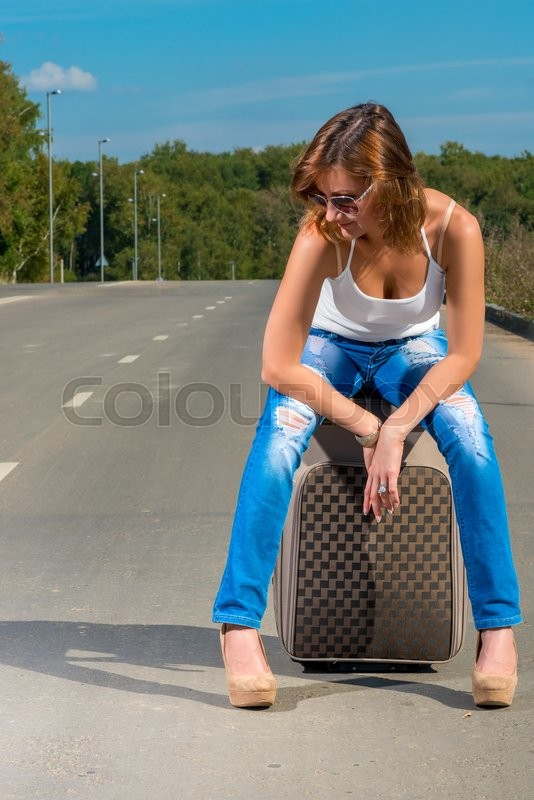 Stock image of 'Girl waiting for of associated car on the road'