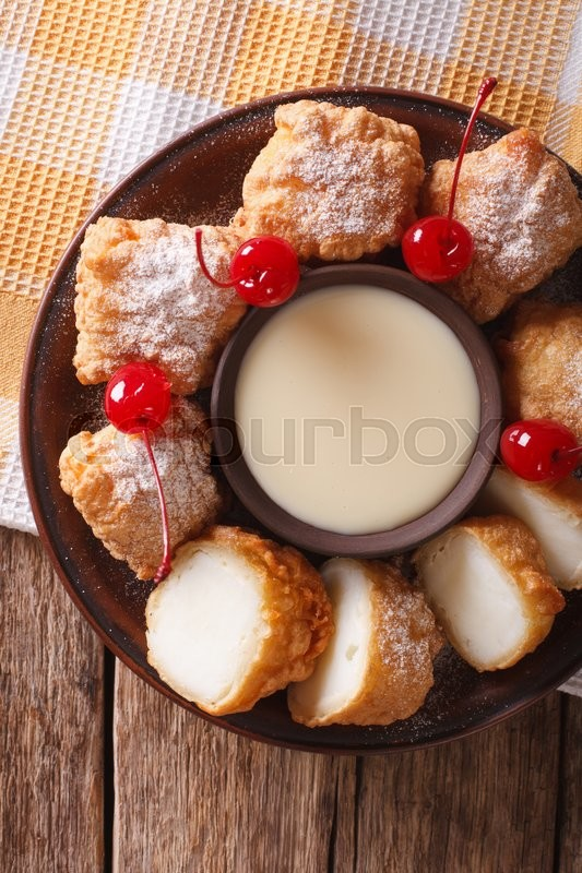 Stock image of 'Fried milk dessert with condensed milk close-up on a plate. vertical view from above\'