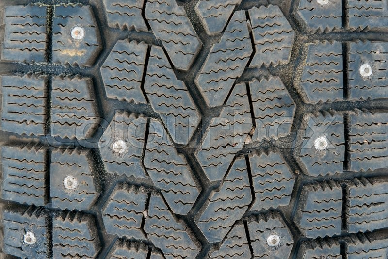 Stock image of 'Protector of winter tires with spikes close-up'