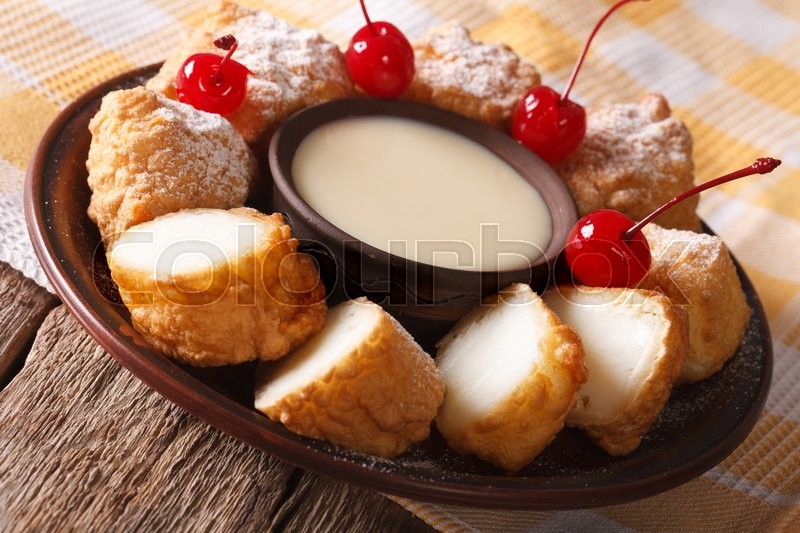 Stock image of 'fried milk and condensed milk decorated with cherries close-up on a plate. horizontal\'