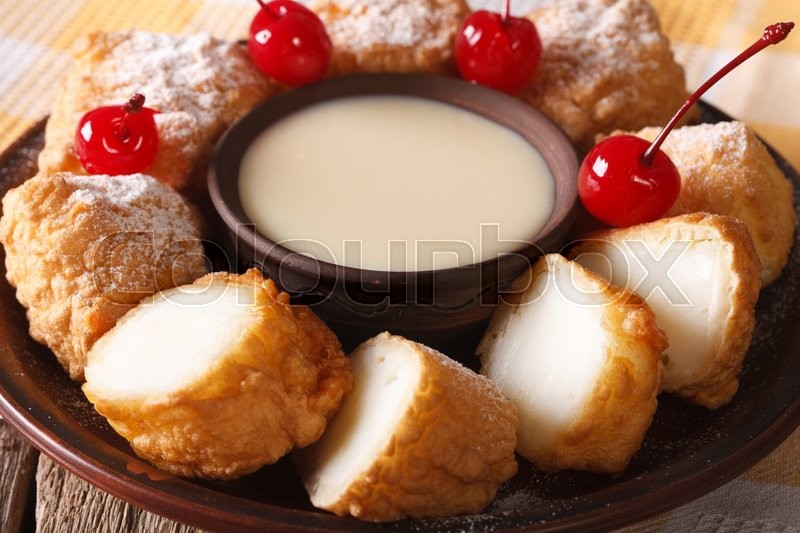 Stock image of 'Fried milk dessert with condensed milk close-up on a plate. horizontal\'