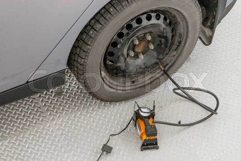 Stock image of 'Automatic bilge pump inflates the the wheel in garage'