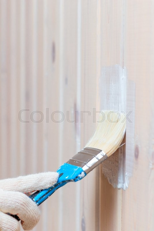 Stock image of 'Covering protective impregnating wooden wall, close-up shot'