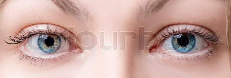 Stock image of 'Two beautiful female eye with lens close up'