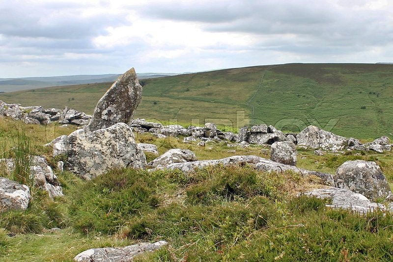 Stock image of 'Grimspound is a late Bronze Age settlement, situated on Dartmoor in Devon, England. It consists of a set of 24 hut circles surrounded by a low stone wall.'