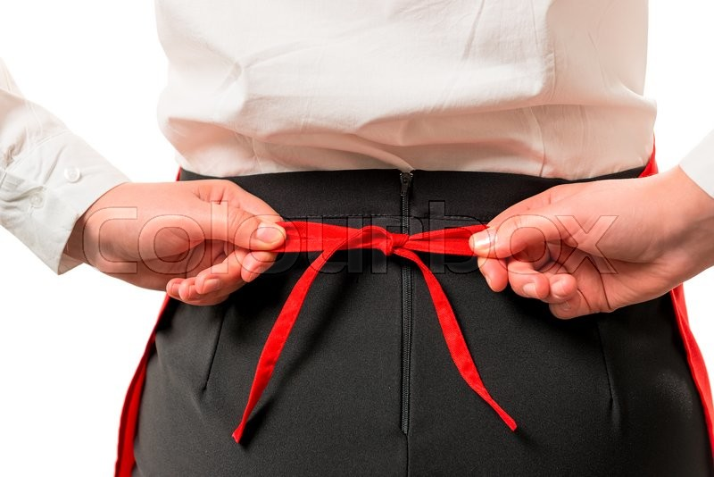 Stock image of 'Girl tying red apron at the waist rear view'