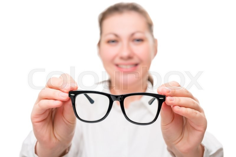 Stock image of 'Girl holding glasses, glasses in focus on a white background'