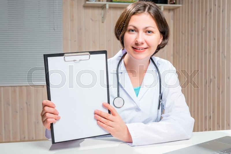 Stock image of 'Doctor keeps a clean sheet of paper for an inscription'