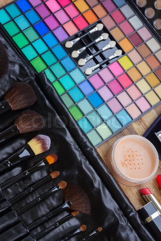 Stock image of 'Set of professional  black brushes with colorful eye shadows'