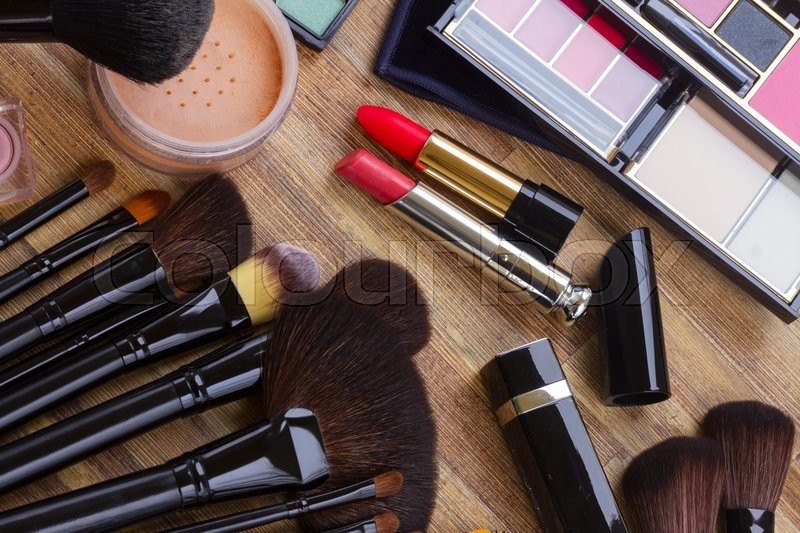 Stock image of 'Set of  black professional brushes, lipsticks, eye shadows and  powder, top view '
