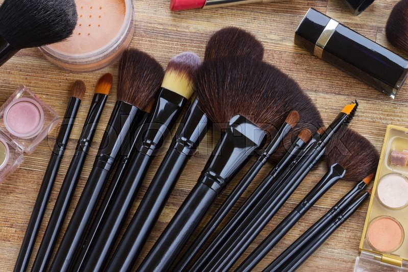 Stock image of 'Set of  black brushes on wooden table, top view '