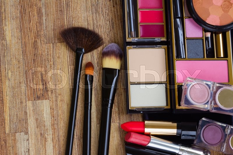 Stock image of 'set of  black brushes, lipsticks, maskara and  eye shadows '