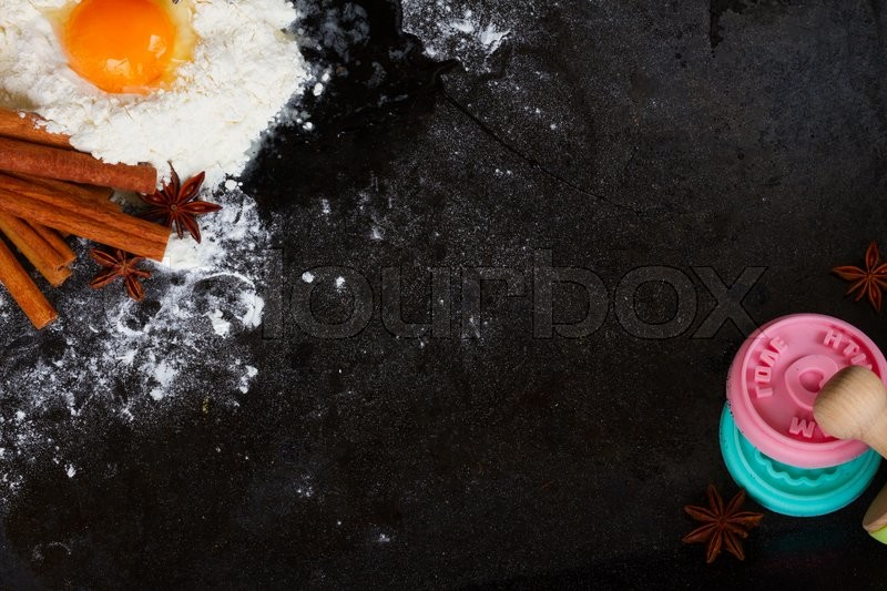 Stock image of 'raw baking ingredients on black background with copy space'