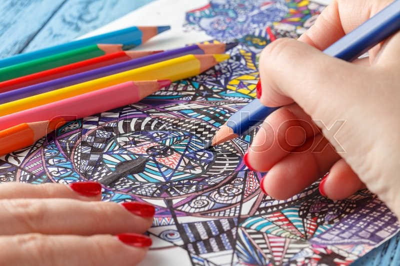 Stock image of 'Adult coloring books on blue table'