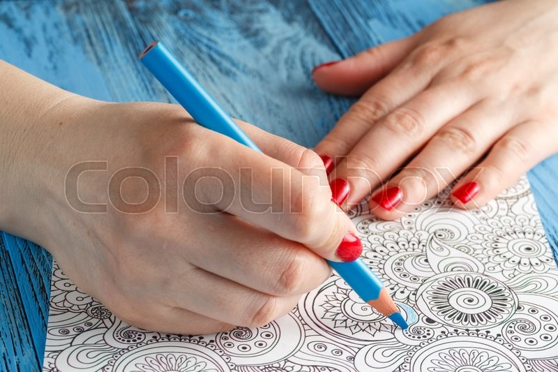 Stock image of 'Adult coloring books colored pencils anti-stress tendency'