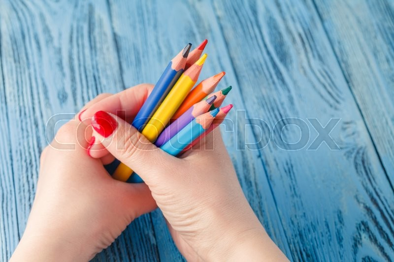 Stock image of 'Coloring pencils bunch in a hand shot  top view'