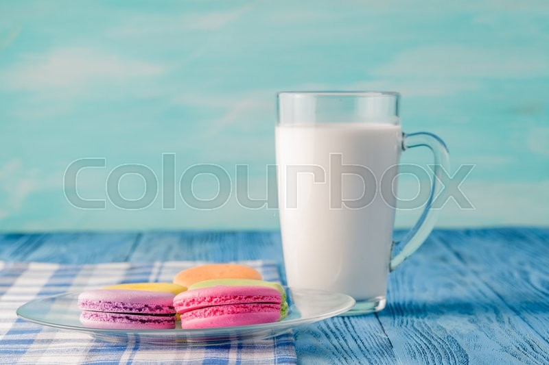 Stock image of 'Colorful macaroons and glss of milk. Kid breakfast concept.'