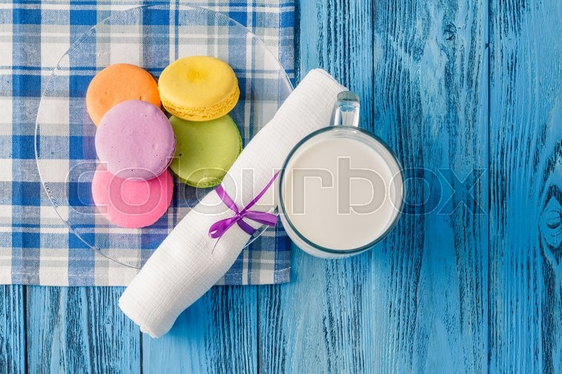 Stock image of 'Colorful macaroons and glss of milk. Kid breakfast conceptю Top view'