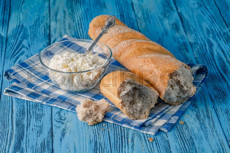 Stock image of 'Ripe bread on blue wooden table'
