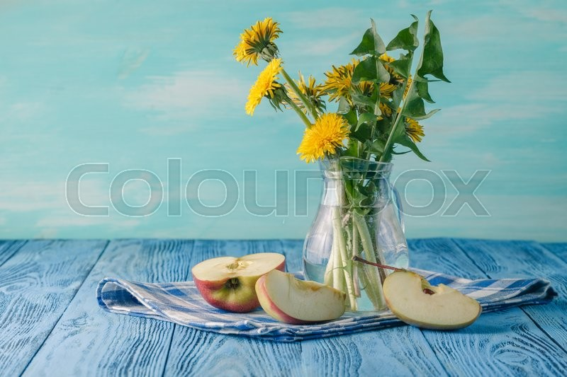 Stock image of 'Spring breakfast on blue wooden table with dendelion flowers'