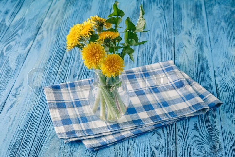 Stock image of 'Spring breakfast with dandelion flowers on blue table'