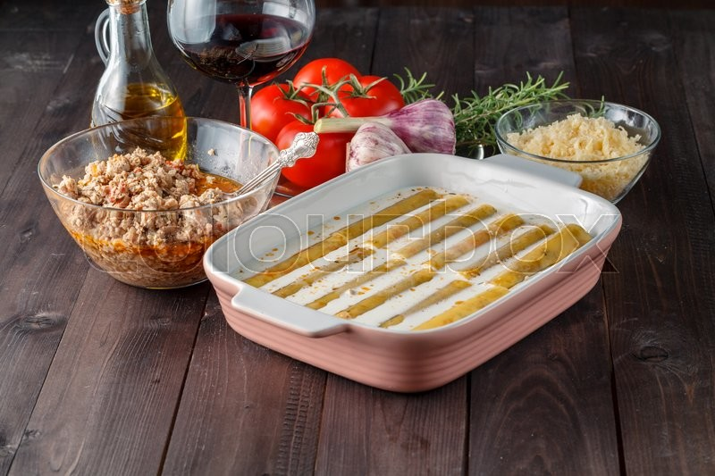 Stock image of 'Woman make cannelloni with cheess. mediterranean cuisine cookind'