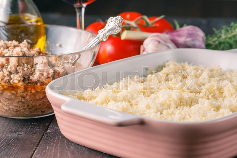 Stock image of 'Homemade traditional lasagna.  raw ingredients on table'