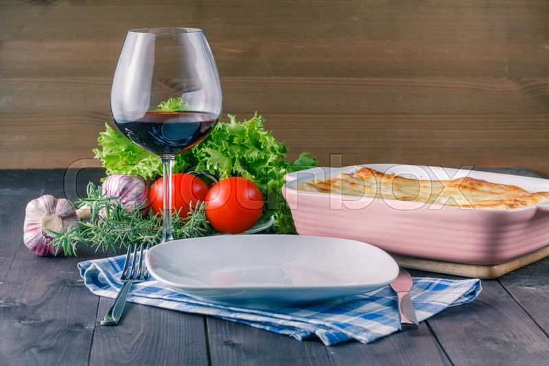 Stock image of 'Healthy salad ingredients on rustic wooden table'