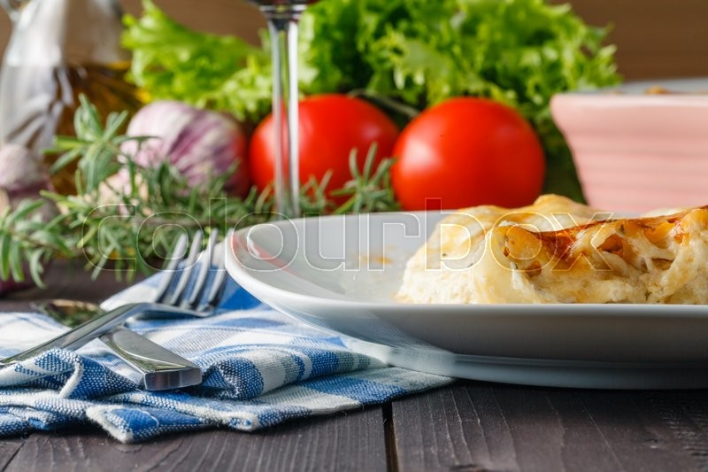 Stock image of 'Realax evening. Home dinner with lasagne and wine'