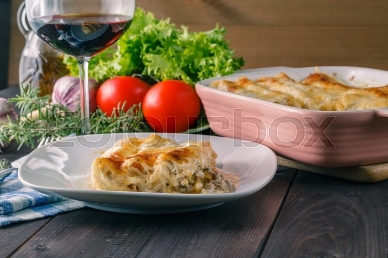 Stock image of 'Potion of lasagne on plate. mediterranean dinned concept'