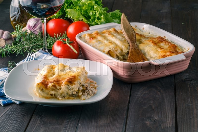 Stock image of 'Hot lasagne on table. Relaxed home dinner'