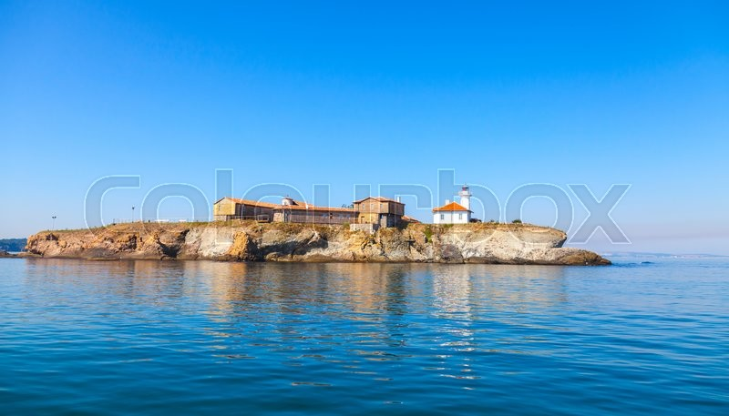 Stock image of 'St Anastasia Island in Burgas bay, Black Sea, Bulgaria. Lighthouse tower and old wooden buildings on rocky coast'