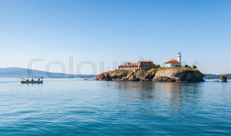 Stock image of 'Saint Anastasia Island in Burgas bay, Black Sea, Bulgaria. Summer coastal landscape with fishermen in wooden boat '