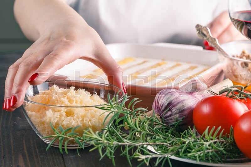 Stock image of 'Woman make cannelloni with cheese. mediterranean cuisine cookind'
