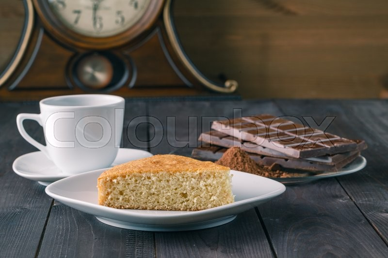 Stock image of 'manna pie on rustic table with chocolade and coffee'