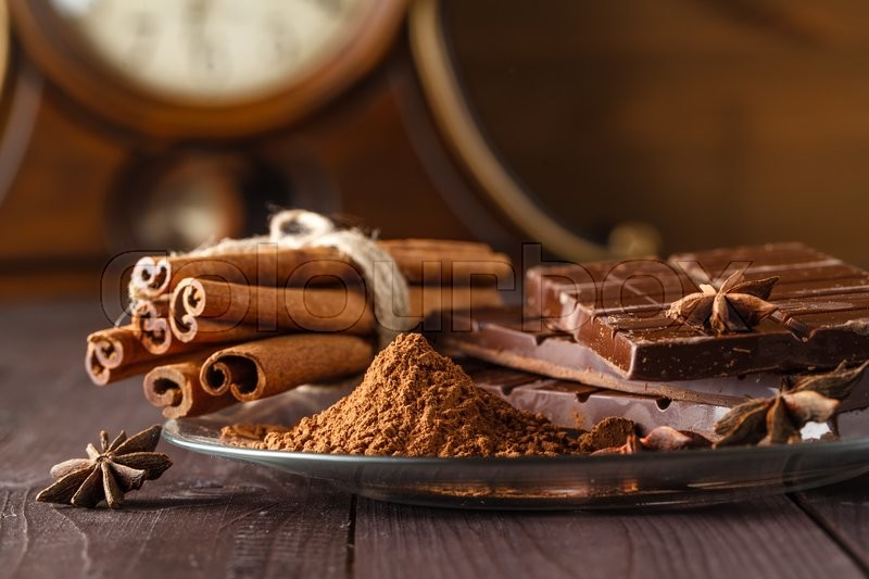 Stock image of 'cocoa and chocolade on wooden table. Closeup view'
