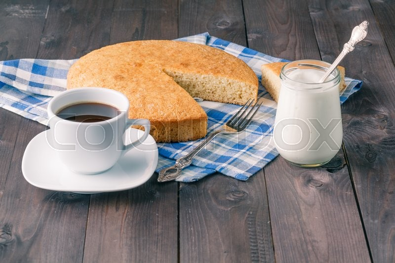 Stock image of 'Organic pie with yoghurt and coffee on wooden table'