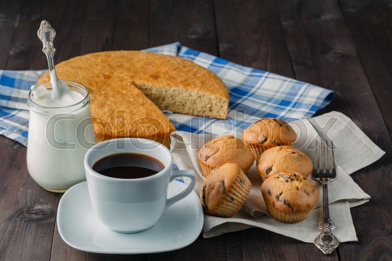 Stock image of 'Organic pastry food. group of muffins and manna pie on table'