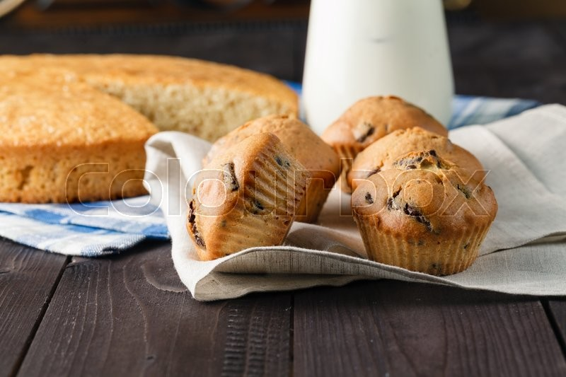 Stock image of 'Closeup view of fresh made muffins on wooden table'