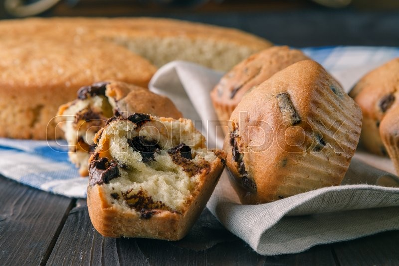 Stock image of 'Closeup view of fresh backed muffins with cocoa and chocolade'